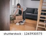 moving into new apartment .... | Shutterstock . vector #1265930575