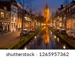 the old church reflected in a... | Shutterstock . vector #1265957362