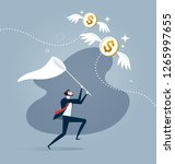 businessman is trying to catch... | Shutterstock .eps vector #1265997655