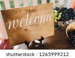 wooden plate with the... | Shutterstock . vector #1265999212