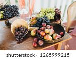 on the wooden table are plates... | Shutterstock . vector #1265999215