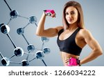athletic woman standing near... | Shutterstock . vector #1266034222
