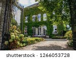 farmhouse in belgium entwined... | Shutterstock . vector #1266053728