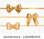 bundle of golden satin ribbons... | Shutterstock .eps vector #1266082432