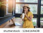 an asian girl is freelancer... | Shutterstock . vector #1266164638