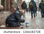 Hungry Homeless Beggar Woman...
