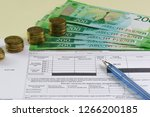 Registration of the receipt in Russian for payment for the consumed water, coins and new banknotes of 200 rubles. Increase in utility tariffs - stock photo