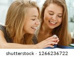 two happy girls trying on... | Shutterstock . vector #1266236722