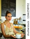brewing coffee in coffeehouse.... | Shutterstock . vector #1266258952
