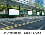 blank billboard at bus stop in... | Shutterstock . vector #1266417355