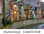 colorful homes on the banks of... | Shutterstock . vector #1266517318