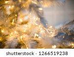 christmas tree closeup  light... | Shutterstock . vector #1266519238