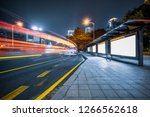 blank billboard at bus stop in... | Shutterstock . vector #1266562618