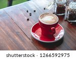 red coffee cup put on an old... | Shutterstock . vector #1266592975