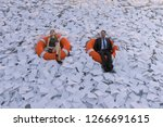 two people are floating on the...   Shutterstock . vector #1266691615
