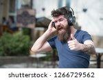 enjoy free songs everyday. man... | Shutterstock . vector #1266729562