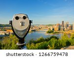 A closeup of Operated Binocular at Grandview Overlook at Sunset overlooking the Pittsburgh Downtown  Pittsburgh, USA.