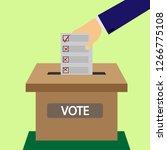 male hand puts a ballot box in... | Shutterstock .eps vector #1266775108
