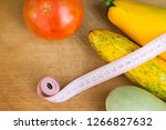 zucchini on a wooden table.... | Shutterstock . vector #1266827632