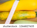 zucchini on a wooden table.... | Shutterstock . vector #1266827635