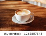coffee cup latte art in cafe on ... | Shutterstock . vector #1266857845