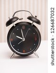 black alarm clock on light... | Shutterstock . vector #126687032