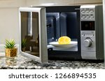 microwave cleaning using lemon  | Shutterstock . vector #1266894535