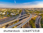aerial view above a freeway in... | Shutterstock . vector #1266971518