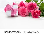 bouquet of roses and gift box...   Shutterstock . vector #126698672