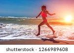 lovely girl  runs  flies on the ... | Shutterstock . vector #1266989608
