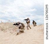 US marines run through the desert through the military operation - stock photo