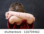 Small photo of Boy with poor spelling and low self esteem