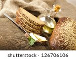 butter and rye bread with sesame seeds - stock photo