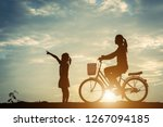 silhouette of mother with her...   Shutterstock . vector #1267094185