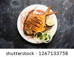 tandoori pomfret fish cooked in ... | Shutterstock . vector #1267133758