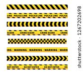 yellow and black caution tapes  ... | Shutterstock .eps vector #1267202698