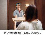 pizza delivery boy gives box to ... | Shutterstock . vector #1267300912