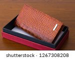 brown leather wallet with box... | Shutterstock . vector #1267308208
