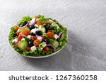 fresh greek salad in plate with ... | Shutterstock . vector #1267360258