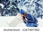 woman with her dog tender scene....   Shutterstock . vector #1267407382