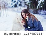 young girl with her dog white...   Shutterstock . vector #1267407385