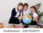 three schoolgirls girls learn... | Shutterstock . vector #1267420375