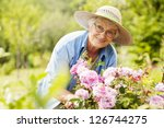 senior woman with flowers in... | Shutterstock . vector #126744275
