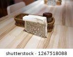 napkin and napkin holder on the ... | Shutterstock . vector #1267518088