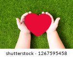 the figure of a red heart in... | Shutterstock . vector #1267595458