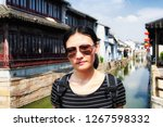 a chinese woman wearing... | Shutterstock . vector #1267598332