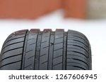summer car tire. rusty nail in...   Shutterstock . vector #1267606945