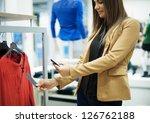 Smiling Woman Scanning Qr Code...