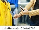 woman scanning qr code in... | Shutterstock . vector #126762266