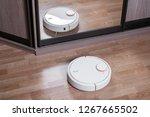 robot vacuum cleaner on... | Shutterstock . vector #1267665502